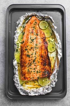 Baked honey cilantro lime salmon in foil is cooked to tender, flaky perfection in just 30 minutes with a flavorful garlic and honey lime glaze. Baked Salmon Recipes, Fish Recipes, Seafood Recipes, Dinner Recipes, Cooking Recipes, Healthy Recipes, Salmon Recepies, Cooking Fish, Cooking Tools