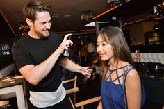 Joico's Celebrity Hairstylist, Paul Norton showing guests how to apply Joico's Hair Shake.