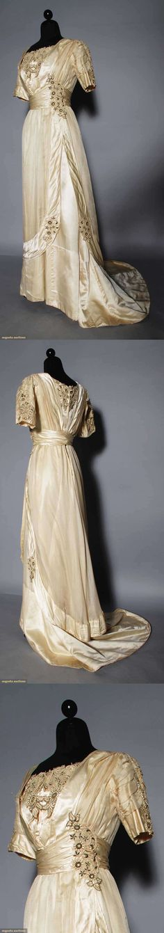 SILK EVENING GOWN, c. 1910. Cream charmeuse, embroidered appliques, trained skirt.