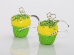 Cupcakes Silver plated hook earrings,green-yellow cupcakes and green sprinkles on top,made out of polymer clay.