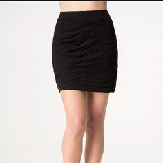 bebe Black Ruched Mini Skirt New with tags attached. bebe Skirts Mini