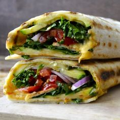 A grilled tortilla loaded with grilled zucchini, veggies, cheese, and hummus! Quick, healthy, and gluten free!