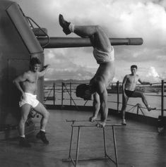 """""""Crewmen exercising aboard a submarine tender (AS) at an advanced base. Men having a workout on deck"""", May 1945 (Horace Bristol)"""