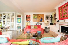 So many fun and eclectic colors. Love the wall art. | Colorful Living Rooms