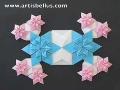 Blue Eyed Grass Flowers an Origami Quilt of interconnected modules, by Artis Bellus. Video tutorial: http://www.youtube.com/watch?v=6ZW4fd6JMkQ&feature=share&list=PLD14EDF415FA59B6F&index=6
