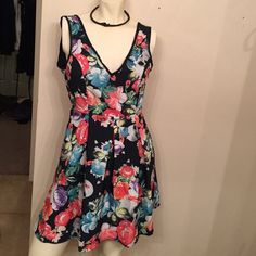 Hot topic Skulls and Flowers dress Short open back mini-dress. Skull and flower design with cute bow on back. Fully lined Dresses Mini