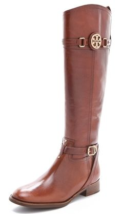 Tory Burch Leather Calista Riding Boots  polished gold hardware add to the luxurious charm. Zip closure at the inner side. Stacked heel and leather sole.   Made in Brazil.