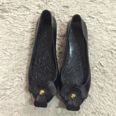 Black Plastic Flats Perfect for any time, you can use them during the rain. 🌂💦 has a flower touch in the front. Used condition. Size 8 but they fit small Shoes Flats & Loafers