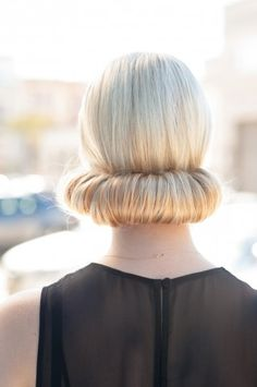 Cool updo! Create by parting hair in middle, take sock bun and cut to make a roll, adjust size to your width of your head. Start rolling hair around tube several inches up from ends, tucking in hair as you go upward. At nape of neck, secure with pins and fan out at edges to cover sock.