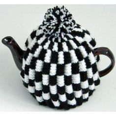 Knit your own tea cosy: http://hobby.blogo.nl/2006/12/09/patroon-theemuts-breien-ea/