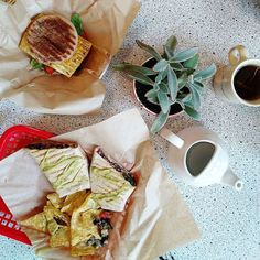 Burrito with tofu scramble and a tofu breakfast sandwich (was a lot yummier than it sounds)  #vo2 #cafe #breakfast #morning #food #morningfood #goodmorning #vegan #vegetarian #vegancafe #tofuscramble #tofu #soy #englishmuffin #burrito #plantprotein #coffee #emk #eastmeetskitchen #healthy #healthyliving #eat #healthyeating #lifestyle #yum #delicious #healthyfood #mornings #hungry #letseat