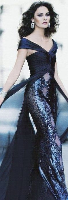 sensational design w/ the material having movement as she walks...gives her a breezy, confident air !