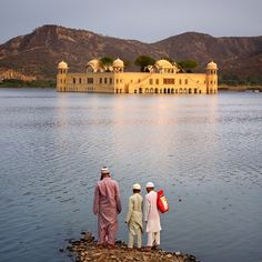 "A family enjoys an afternoon before the Jal Mahal or ""Water Palace,"" located in the middle of Man Sagar Lake in Jaipur city, the capital of the state of Rajasthan, India. The stunning palace, built in red sandstone, is a five storied building out of which four floors remain under water when the lake is full and the top floor is exposed. Earlier this month, the Rajasthan Assembly passed Rajasthan River Basin and Water Resources Planning bill 2015 for management, development of river basins…"