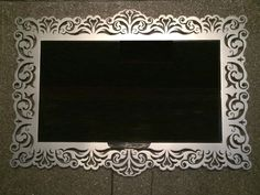 Laser cut metal TV frame. Badass!!! Even get a pattern made for a simple mirror