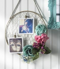 Jazz up a wire hanging photo holder with faux flowers in this unique DIY floral project! Easy to make in any colors you like and display on the wall. MichaelsMakers Mod Podge Rocks