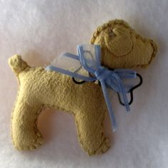 This little dog is super soft because it is made from a chammy. He wears a blue ribbon bow. His bone is a real paper clip. A pin back has been added. He is made from an original pattern. Blue Ribbon, Ribbon Bows, Dog Pin, Felt Decorations, Paper Clip, Felt Animals, Little Dogs, Paper Dolls, Robots