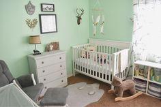 woodland theme nursery, mint walls, gender neutral, bear rug, so cute.