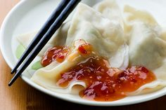 Pork Dumplings with Chili Sauce Recipe with napa cabbage, kosher salt, fresh ginger, chinese chives, ground pork, ground white pepper, soy sauce, chinese rice wine, sesame oil, dumpling wrappers