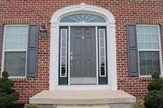 Thinking about upgrading your windows and doors and wondering about the exterior color options? Your front door and window trim color can say a lot about Grey Front Doors, Painted Front Doors, Front Entry, Entry Door With Sidelights, Entry Doors, Entrance Hall, Latest Door Designs, Front Door Images, Halloween Front Doors