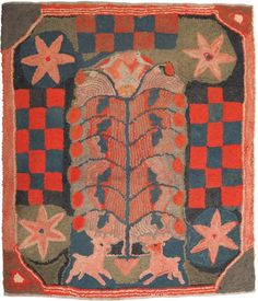 "American hooked rug, 19th c., depicting two stags beneath a stylized floral tree, 42 1/2"" h., 36"" w."