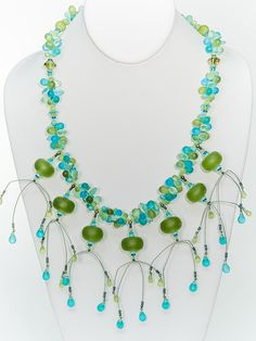 Two Son Jewelry - Lime Green Resin Saucer Necklace, $127.00 (http://www.twosonjewelry.com/products/lime-green-resin-saucer-necklace.html)