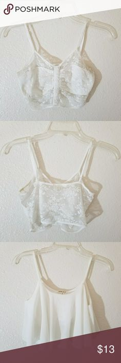 Crop top bundle White crop top bundle The first one is a floral lace bralette top and the 2nd one is a flowy chiffon top Both in good condition but 1st one has deodorant stains but not noticeable when worn Not f21 uo charlotte russe Charlotte Russe Tops Crop Tops