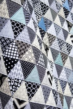 Triangle quilt by Stacy at Freshly Handmade. Made with 15 different white prints, 15 different black prints and 8 different blue solids and prints. Each triangle measures Quilted with straight lines on both sides of the horizontal and diagonal seams. Boy Quilts, Scrappy Quilts, Man Quilt, Star Quilts, Quilting Projects, Quilting Designs, Quilt Inspiration, Colour Inspiration, Black And White Quilts