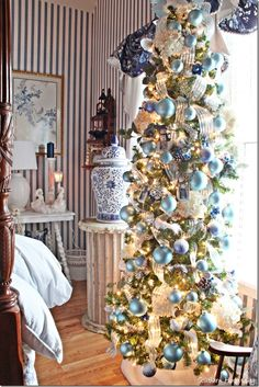 I want a tall, skinny tree like this. Beautiful but doesn't take up a lot of room.