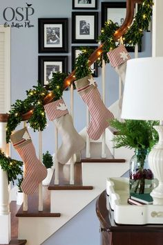 Festive Christmas stockings lined up on a stairway banister | Easy ideas for adding a pop of Red to your Christmas decor that are budget-friendly and fun. Lots of examples and suggestions for any style. #Sponsored