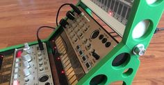 The stand holds three Korg Volca devices in a modular-style setup.