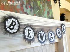 LOVE this banner!!  Doesn't have to be for Halloween, this would be cute for any occasion in different colors. I just adore the tulle and doilies.