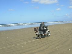 The hubby takes off down 90 Mile Beach on our Triumph Scrambler!