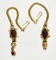 ~ Pair of earrings with female head pendants. Date: late 2nd century B.C.- A.D. 2nd century Medium: Gold, garnet