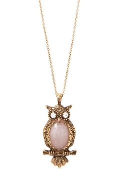 This longline pendant necklace features a burnished finish, lobster clasp closure, and an etched owl pendant with a faux stone body and rhinestone eyes.