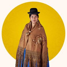 Bolivia's cholitas, with their bowler hats and layered skirts, were once targets of discrimination. Now cholita fashion is a source of pride. Bolivia, Local Women, Bowler Hat, Layered Skirt, World Cultures, Outfit, Cowboy Hats, Cool Photos, Celebrities