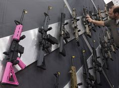 NRA courts women: Pink rifles, concealed carry purses on display at convention (Photo: Adrees Latif / Reuters)