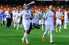Real Madrid CF players Pepe and Sergio Ramos celebrate with the trophy after winning the Copa del Rey Final between Real Madrid and FC Barcelona at...