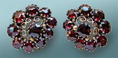 Dorrie Nossiter. Arts and Crafts earrings. Silver, gold and garnet, c. 1930. Length: 2.1 cm, width: 2.3 cm (0.8 x 0.9 in). Fitted case. Sold by Tadema Gallery. View 2.