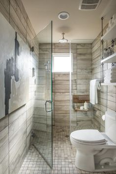 Bathroom Ideas:  Wall tile that looks like old/reclaimed wood.  Check out the shelving on the right - it's hung from the ceiling!