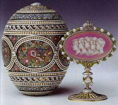 """""""The Mosaic Egg"""" by Alma Pihl from Faberge House was the last egg before WW I began. The egg was created for Nikolay II as a traditional Easter present for his wife and Russian Empress Alexander Feodorovna in 1914. The surprise inside the egg presents a pink and white cameo with contours of children of Nikolay II and Alexandra Feodorovna. Today the egg is owned by Elizabeth II, Her Majesty The Queen of the UK and the other Commonwealth realms."""