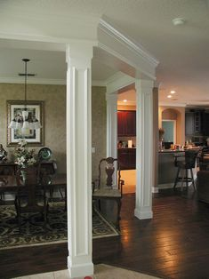i love how they use columns to separate the dining room. | home
