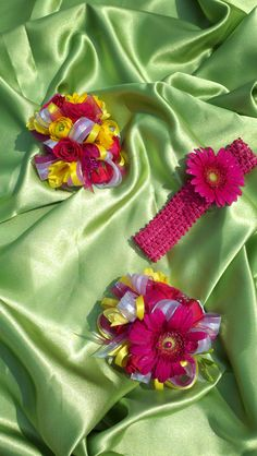 hot pink and bright yellow wedding ~ wrist corsages and a sweet headband for a baby girl with a single gerbera daisy