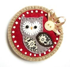This is a lovely handmade fabric brooch. It features a little felt owl with appliqued wing and belly in pretty Liberty print fabric. It is mounted onto a red felt base which is edged with cream seed beads. It is further mounted onto a light brown felt. Felt Owls, Felt Birds, Felt Animals, Fabric Brooch, Felt Brooch, Felt Fabric, Bird Crafts, Cute Crafts, Crafts To Make