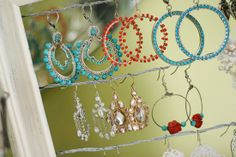 An old frame and some wire. Coolest earring storage.