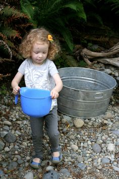 Natural Rock Play Space and Outdoor Kitchen from Fun at Home with Kids