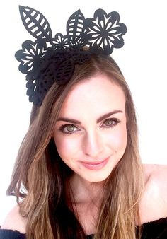 Crown-like fascinators are all the rage at the races these days - hence our OANA headpiece, designed & made by SHOW PONY Millinery in New Zealand. The perfect little black crown / fascinator for anyone wanting to look hot to trot at a major event such as the Melbourne Cup, Ascot or even a wedding, she also comes in red for those seeking a statement piece.  Made out of laser cut felt, she also makes for a great choice of headpiece for a winter days racing.  * One size fits all * Hand-crafted…