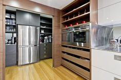 Love that the ref. and pantry are hidden away by sliding doors.  By Australian interior designer, Darren James.