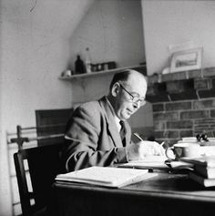 C.S. Lewis writing at his desk at home, The Kilns, 1950s