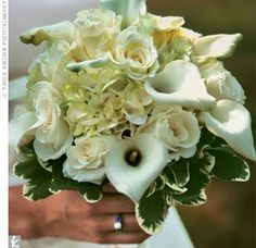 white roses and calla lilies, with green hydrangea accents