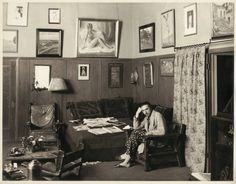 Bela Lugosi relaxing in his home in the 1930s. . Centered on the wall is his nude oil painting he had commissioned of actress Clara Bow, with whom he had a brief affair.  Thank you Dmitry Polgar